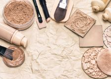 Retro stylized makeup foundation set with copy space. Cosmetic products and accessories for corrective make-up on aged paper. Retro stylized makeup foundation Royalty Free Stock Photos