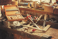 Retro stylized old tools on wooden table in a joinery Stock Image