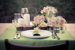 Retro stylized photo of  table setting in rustic style. Stock Photography