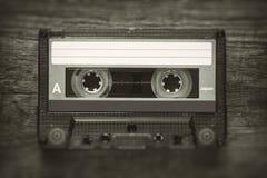 Retro stylized photo of vintage cassette tape with blur and noise effect. Retro stylized photo of vintage Audio cassette tape with blur and noise effect stock photo