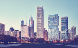 Retro stylized picture of Chicago downtown at twilight. Royalty Free Stock Image