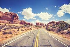 Retro stylized scenic road, Arches National Park, USA Stock Photo