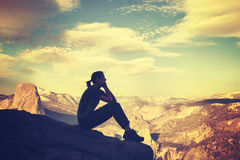 Retro stylized silhouette of a woman watching mountain view. Royalty Free Stock Photos