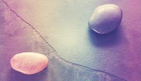 Retro stylized stones on a cracked slate. Royalty Free Stock Photo