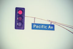 Retro stylized traffic lights and Pacific Av street sign, USA Stock Image