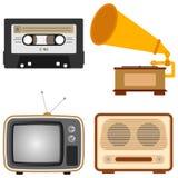 Retro subjects. An old TV, a retro radio, a gramophone, an audio cassette Stock Photos