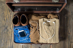 Retro suitcase with casual woman clothes Royalty Free Stock Photos