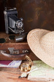 Retro suitcase and compass. Antique travelling tools and maps and a vintage suitcase Stock Image