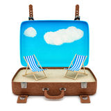 Retro suitcase with 2 deckchairs Stock Images