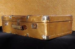 Retro suitcase. Old retro suitcase on black velvet Royalty Free Stock Photo