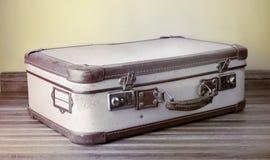 Retro suitcase put on wooden floor stock image