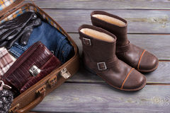 Retro suitcase and shoes. Suitcase with men's clothing and accessories. Retro suitcase and shoes Royalty Free Stock Images