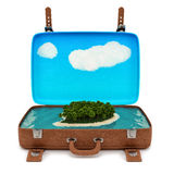 Retro suitcase with a small island Royalty Free Stock Photos