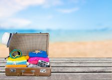 Retro suitcase with travel objects on  background Stock Images