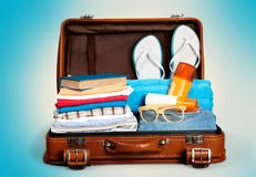 Retro suitcase with travel objects on  background Stock Photos