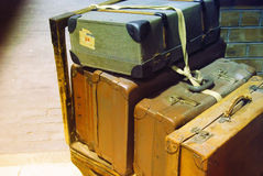 Retro suitcases. Old style suitcases on wooden trolley Stock Image