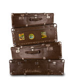 Retro suitcases. Pile of retro suitcases, isolated on white background Royalty Free Stock Image