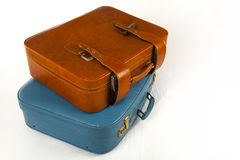 Retro Suitcases. Two retro suitcases on bed Royalty Free Stock Images