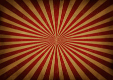 Retro Sun Beam Background. Retro grunge radial star burst or sun beam antique background with old vintage paper texture of red streaks radiating from the center Stock Images