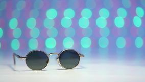 Retro sunglasses as travel concept on a blurry colorful background stock video footage