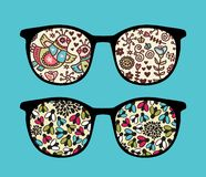 Retro sunglasses with birds reflection in it. Stock Photos