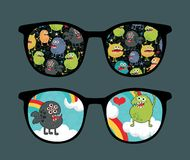Retro sunglasses with monster sky reflection. Stock Photos