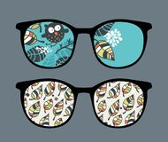 Retro sunglasses with owl reflection in it. Royalty Free Stock Images