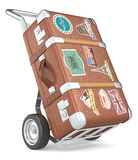 Retro Suticase. Vintage suitcase with retro travel stickers on a trolley Stock Photos
