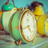 Retro syled image of ancient alarm clocks Stock Image