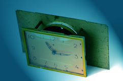 Retro  table alarm clock ,plate Royalty Free Stock Images