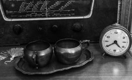 Retro table with clock and radio stock images