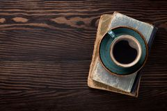 Retro table with vintage items. Coffee cup and old books. Top view with space for your text stock photos