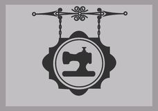 Retro tailor sign of sewing machine Royalty Free Stock Photography