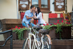 Retro tandem bicycle near red flowers Royalty Free Stock Images