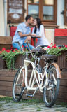 Retro tandem bicycle near red flowers Royalty Free Stock Photos