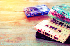Retro tape cassette over wooden table. With flare light - vintage color effect styles Royalty Free Stock Images