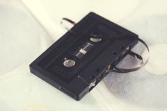 Cassette on table. Retro tape cassette on the white table royalty free stock photos
