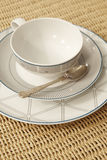Retro tea or coffee cup with tablecloth and spoon detail Royalty Free Stock Image