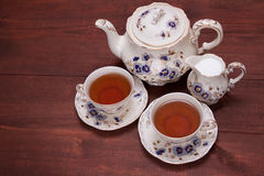 Retro tea set. On the wooden table Royalty Free Stock Image