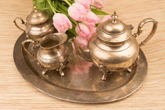 Retro tea time set. Set with flowers for tea time in metal bronce retro style Royalty Free Stock Photography