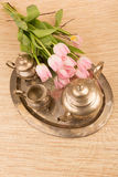 Retro tea time set. Set with flowers for tea time in metal bronce retro style Stock Photos