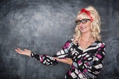Retro teacher in glasses smiling Royalty Free Stock Photos