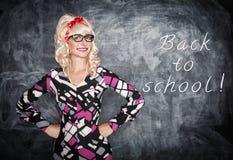 Retro teacher in glasses smiling Stock Image