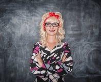 Retro teacher in glasses smiling Royalty Free Stock Images