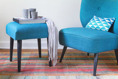 Retro teal armchair and matching ottoman with decor objects horizontal Royalty Free Stock Images