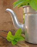 Retro teapot with leaf mint Royalty Free Stock Image
