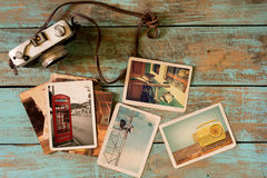 Retro technology instant photo album on wood table stock images