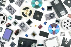 Retro technology and new media on a white background. Flat lay. Old retro technology and new media on a white background. Flat lay Royalty Free Stock Photography