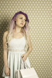 Retro teen with shopping bags Royalty Free Stock Photo