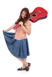 Retro teenage girl with red guitar Stock Image